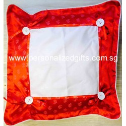 RED BUTTON CUSHION